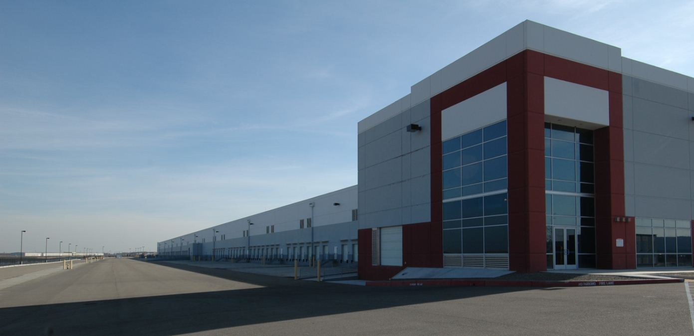Usaa real estate co acquires a two building industrial for Industrial modern homes for sale